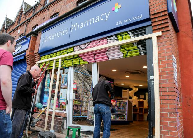 The scene at McKenzie's Pharmacy on the Falls Road yesterday