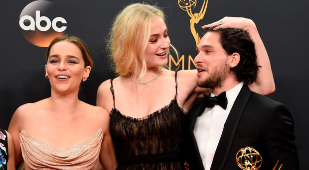 Game of Thrones actors Emilia Clarke, Sophie Turner and Kit Harington at the Emmys. (Photo by Frazer Harrison/Getty Images)