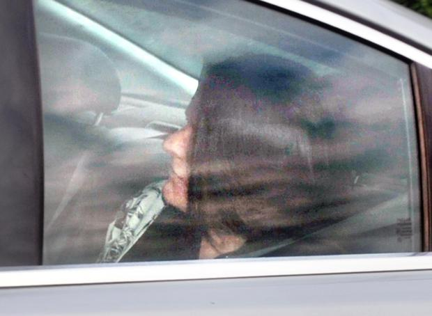 Eilish MacSherry is driven from Dungannon Crown Court following an earlier court hearing.