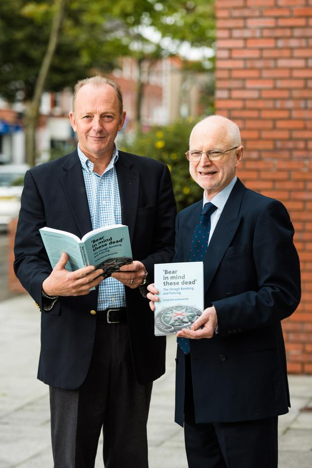 Sir Desmond Rea (right) and Sir Hugh Orde at the launch of their book