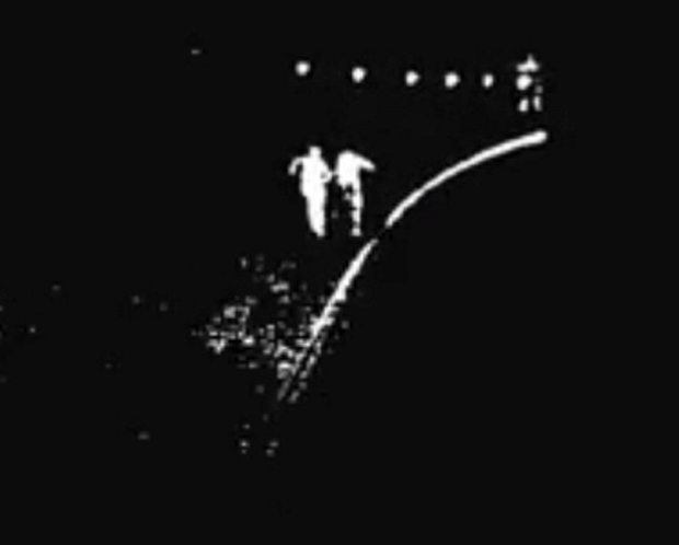 Two people in the tunnel are seen running from the approaching train