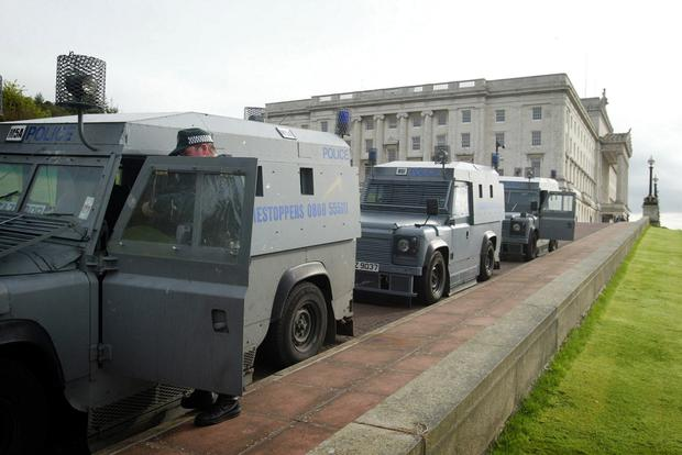 Police prepare to leave Stormont after a raid on the Sinn Fein office in 2002