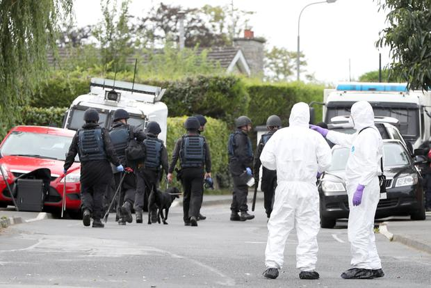 Forensic teams and a police dog carried out searches at properties in the Lurgan area on Wednesday.