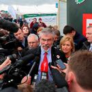 Sinn Fein president Gerry Adams speaks to media