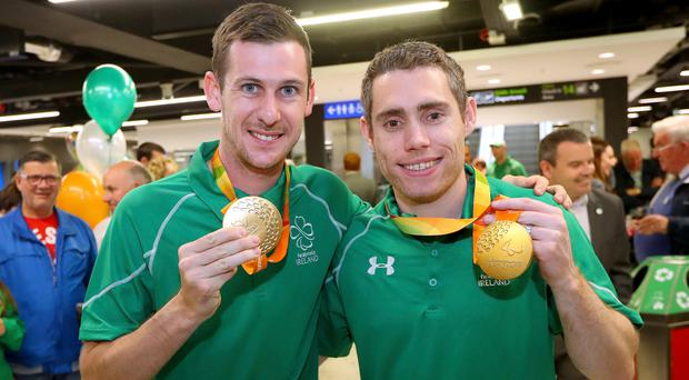Gold medallists Michael McKillop and Jason Smyth at Dublin Airport