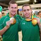 Gold medallists Michael McKillop and Jason Smyth on arrival at Dublin Airport