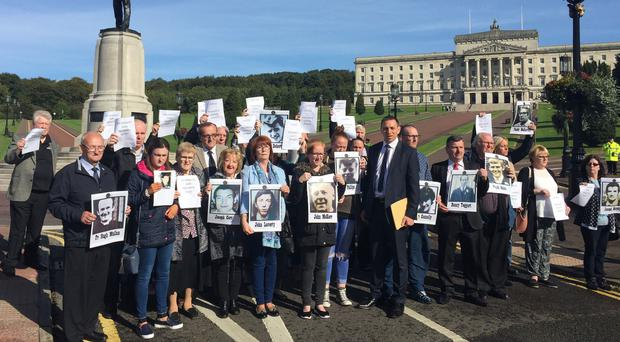 Families impacted by inquest delays outside Stormont in Belfast