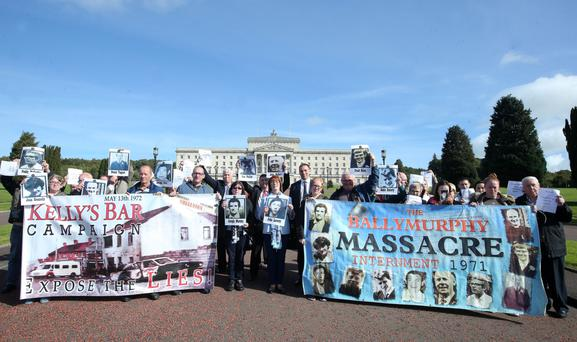 A cross-community group gather at Stormont to deliver the legal letters