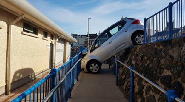 The scene where the car went over the wall at Portstewart promenade