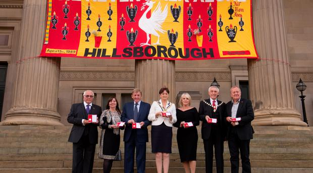 Trevor Hick, Margaret Aspinall, Kenny Dalglish, Lord Mayor Roz Gladden, Marina Dalglish, Lord Mayor's Consort Roy Gladden and Professor Phil Scraton with their Freedom of the City medals