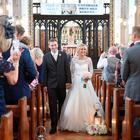 Olympic gold medallists Jason Kenny and Laura Trott during their wedding ceremony at St Alban's Catholic Church in Macclesfield yesterday. Photo credit should read: Joe Gardner/PA Wire