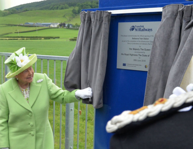 The Queen unveils the plaque on the platform at Bellarena Station