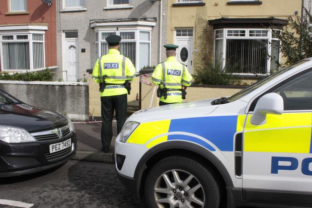 Police at the scene of the attack on a man in his 50s outside a house on the Ballycastle Road, Coleraine