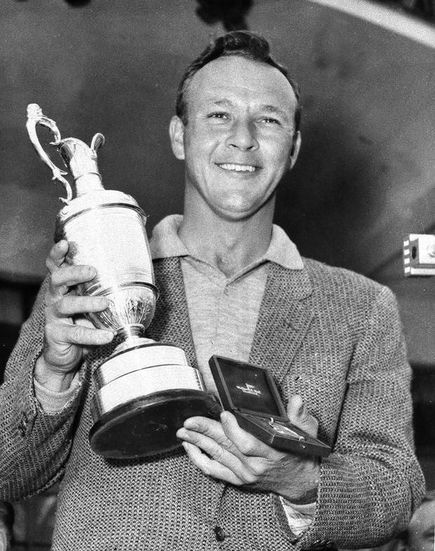 Arnold Palmer with the Open Championship trophy after winning in 1961