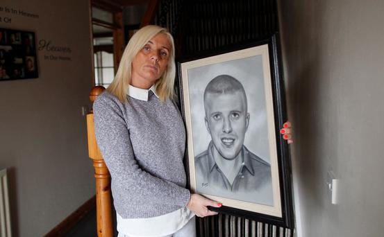Tracy Carnahan with a picture of her son, Sean Paul