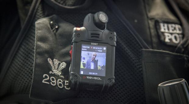 A University of Cambridge study looked at the use of police body cameras (North Wales Police/PA)