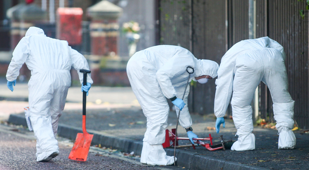 Forensics officers at scene of the shooting in south Belfast