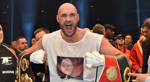Tyson Fury celebrating his world title win last year