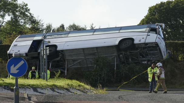 The scene of the accident on the A76 that killed one man and left 18 other people in hospital