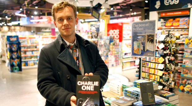 Reporter Luke Barnes with a copy of Charlie One, which the MoD wants the Irish publisher to withdraw
