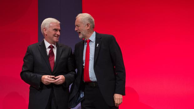 Labour leader Jeremy Corbyn with John McDonnell following his speech during the party's conference in Liverpool