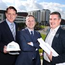 Mark Reilly from the Belfast Telegraph (left) welcomes new Belfast Telegraph Property Awards judges Paul Crowe, president of the Royal Society of Ulster Architects (right), and Ben Collins, regional director NI of the Royal Institution of Chartered Surveyors
