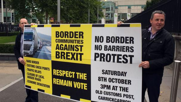 Campaigners outside Belfast's High Court, where a legal challenge to Brexit is taking place
