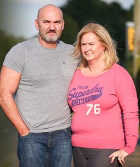 Liz Arnott and husband Mark outside their home in Moira