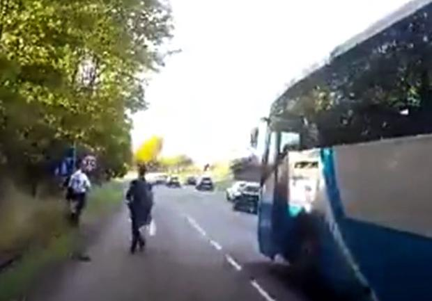 Video footage shows children getting off bus