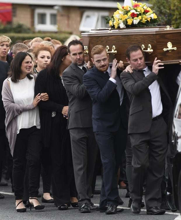 Family and friends during the Funeral of Nathan Ritchie