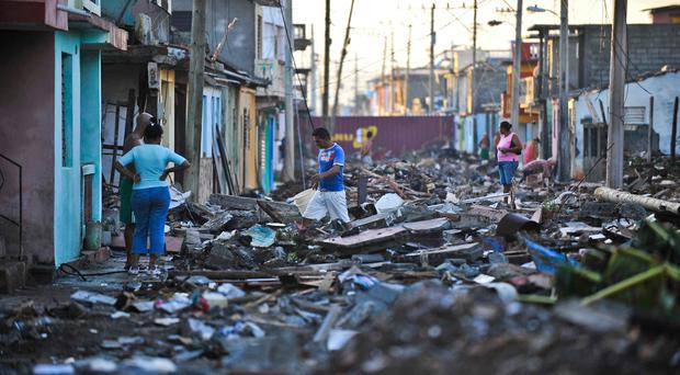 Inhabitants of Baracoa, Guantanamo province, east of Cuba, clean up after hurricane Matthew passed through