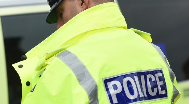 Road sealed off amid reports of woman with gun in street