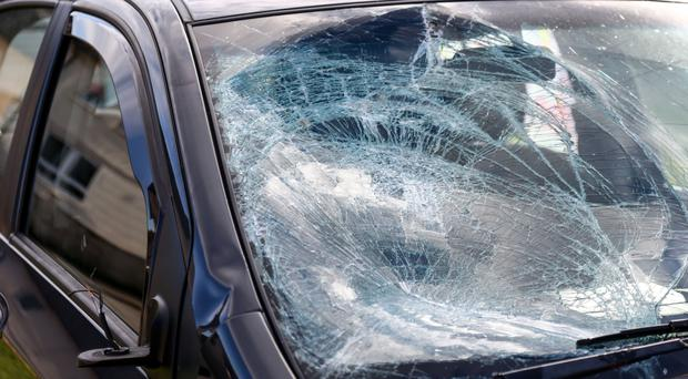 The damaged windscreen of the car involved in a collision with a child wearing a Halloween mask in west Belfast on Saturday