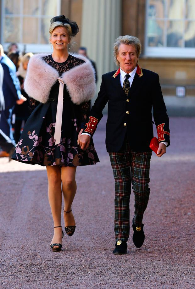 Sir Rod Stewart leaving Buckingham Palace yesterday with his wife, Penny Lancaster