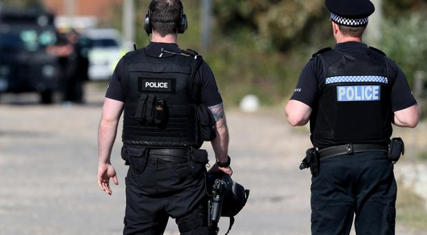 Police in the UK should be armed in the same way as colleagues in Northern Ireland, says an MP