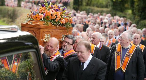 The funeral of Orange Order Grand Secretary Drew Nelson wends its way to St John's Church, Upper Kilwarlin, Hillsborough