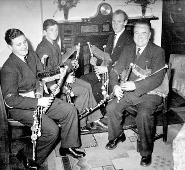 Leo Rowsome (far right) and his friends piping