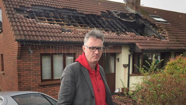 Paul Reilly outside his house in Downpatrick, Co Down, after it was probably struck by lightning