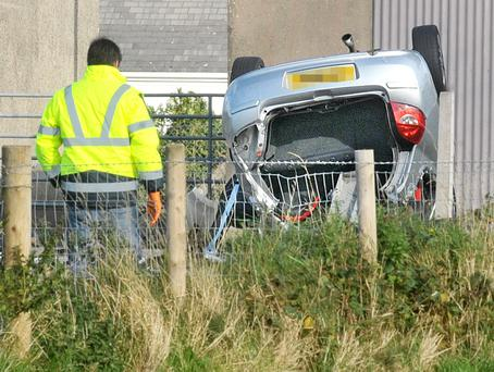 An overturned car on the Mahon Road near Portadown