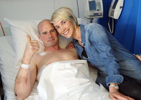 Ryan Farquhar with his wife Karen by his bedside as he recovers from his North West 200 race crash