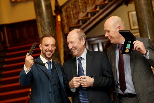 Irish Minister for Transport, Tourism and Sport Shane Ross presents hero rescuer Davitt Walsh with a medal for his brave rescue of a baby girl from a sinking car at Buncrana harbour at the National Marine Gallantry and Meritorious Service Awards 2016 at a ceremony in Farmleigh House in the Phoenix Park, Dublin. PIC: MAXWELLPHOTOGRAPHY.IE