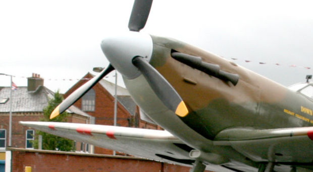 One of the few remaining airworthy Spitfire planes was involved in a near-miss with a light aircraft following an air display, an official report has revealed. File image