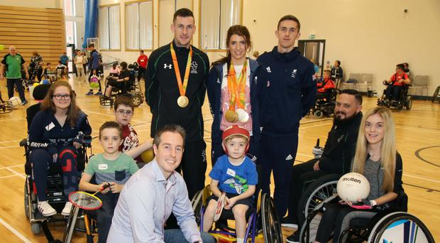 Communities Minister Paul Givan MLA launches the Active Living: No Limits action plan with Disability Sport NI participants Shane, Cormac, Oran and Jayne and paralympians Claire Taggart, Michael McKillop, Bethany Firth, David Leavy and Phillip Eaglesham at a Paralympic Fun Day at Girdwood Community Hub