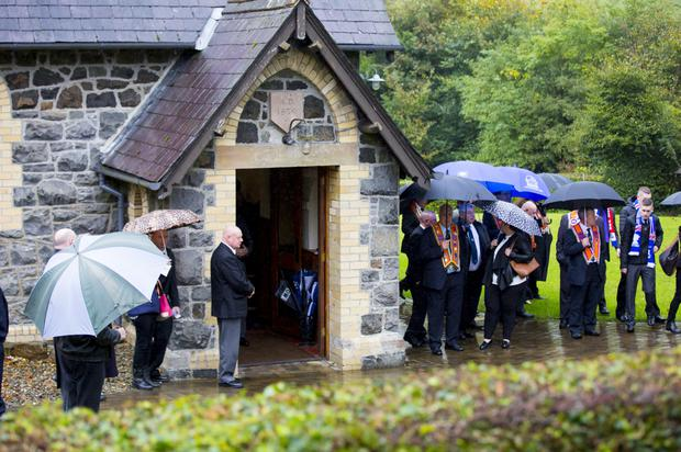 Mourners at the funeral of Rangers fan Ryan Baird at Magheramourne Presbyterian Church in Larne on Saturday