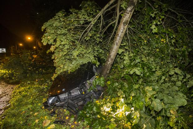 A car, believed to be used by joyriders, crashed on the Old Golf Course Road near Dunmurry on Saturday night