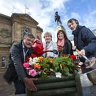 General parks manager Paul Jess, the Mayor of Causeway Coast and Glens Borough Council Maura Hickey, economic development officer for town management Julienne Elliott and parks supervisor James McClements celebrate Coleraine winning the Large Town title at this year's Britain in Bloom competition