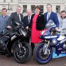 From left, rider John McGuinness, Ian Paisley MP, North West 200 race director Mervyn Whyte, First Minister Arlene Foster, Communities Minister Paul Givan, and riders Lee Johnston and Steve Plater announce the £124,000 funding package at the front of Parliament Buildings, Stormont