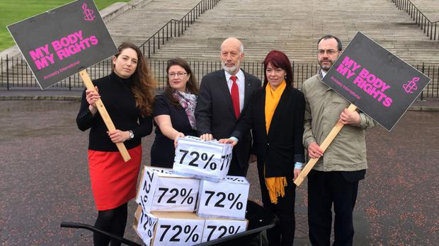 (Left to right) Adrianne Peltz of Amnesty International, Kellie Armstrong and David Ford of the Alliance Party, Claire Bailey of the Green Party and Patrick Corrigan of Amnesty International, deliver a petition calling for a change in Northern Ireland's abortion laws