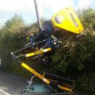 The man in his 60s was cutting a hedge using his tractor near Cloughey when the vehicle overturned onto the road