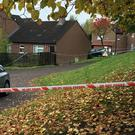 A police cordon at Glenwood Court in west Belfast after a man was shot dead